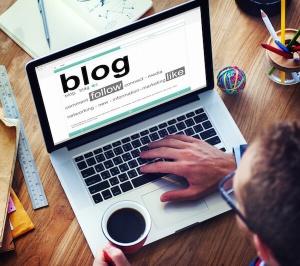 Blog, Laptop, Coffee, Man reading blog, Digital Marketing